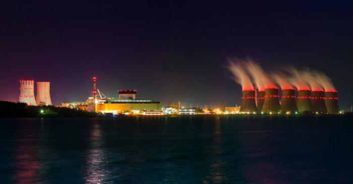 Night view of cooling towers of the Novovoronezh nuclear power plant from the cooling pool - Image