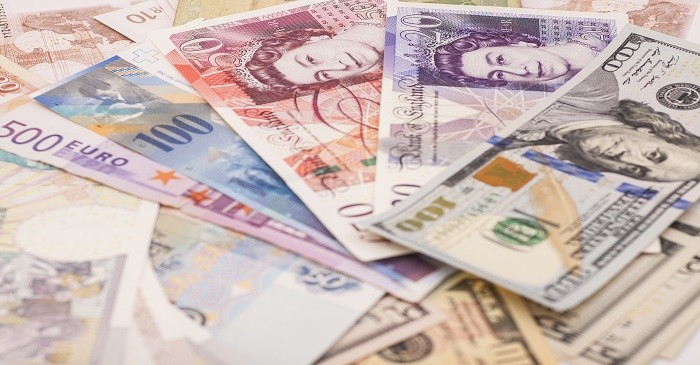 How can exchange rates affect a business