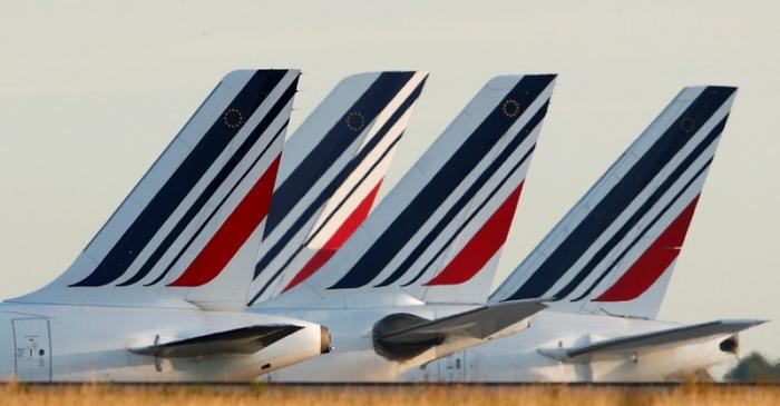 FILE PHOTO: Tails of Air France airplanes are seen at Charles de Gaulle airport near Paris