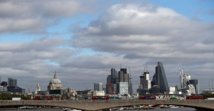 FILE PHOTO: Buildings in the City of London are seen behind Waterloo Bridge in London