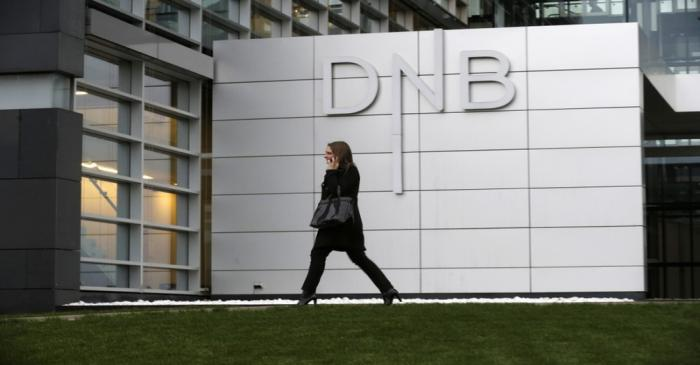 A woman walks past DNB bank's local office in Riga