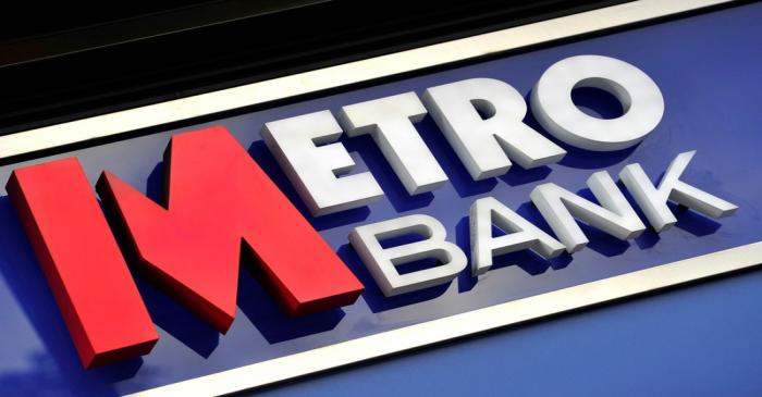 FILE PHOTO: A logo is seen on the outside of a branch of Metro Bank in central London
