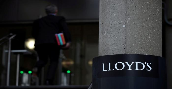 FILE PHOTO: A man enters the Lloyd's of London building in the City of London financial