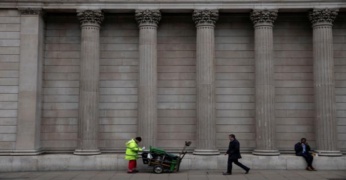 FILE PHOTO: People are seen outside the Bank of England in London