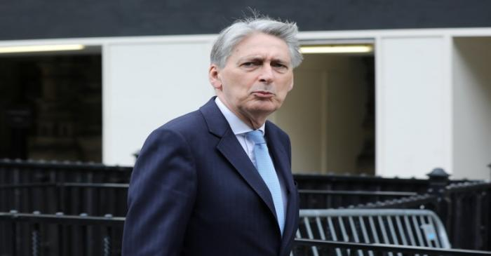 British Chancellor of the Exchequer Philip Hammond is seen near the Houses of Parliament in