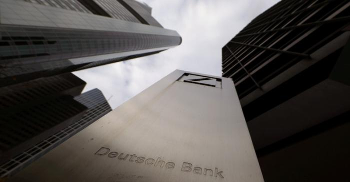 FILE PHOTO: The logo of Deutsche Bank is seen in front of one of the bank's office buildings in