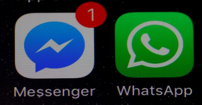 FILE PHOTO: WhatsApp and Facebook messenger icons are seen on an iPhone in Manchester ,