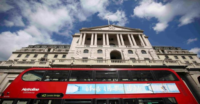 FILE PHOTO: A bus passes the Bank of England in London