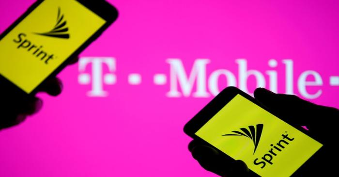 FILE PHOTO: A smartphones with Sprint logo are seen in front of a screen projection of T-mobile