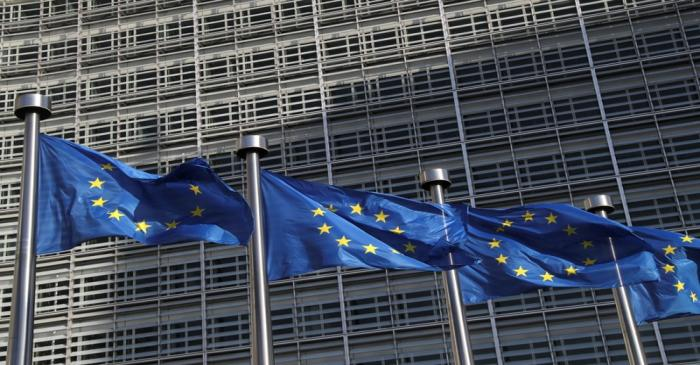 European Union flags flutter outside the European Commission headquarters, in Brussels