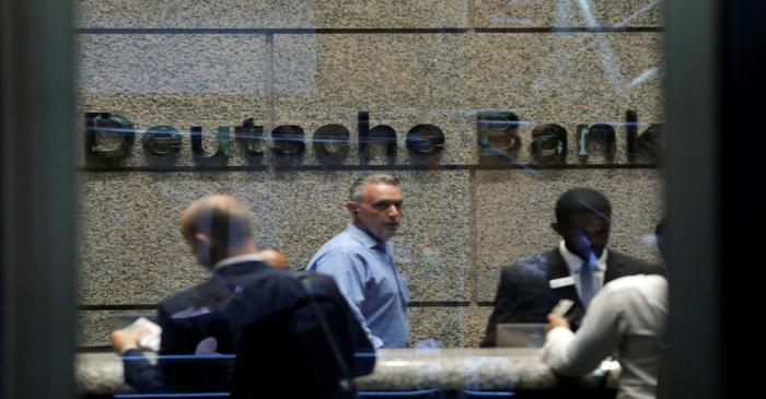 People are seen in the lobby of the U.S. headquarters of Deutsche Bank in New York City