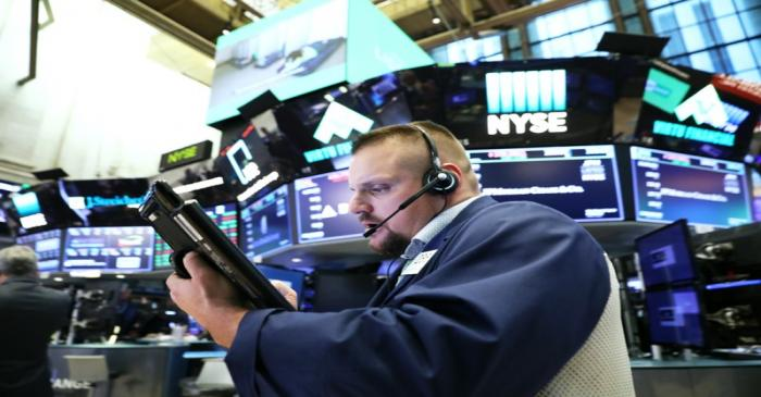 A trader works on the floor of the New York Stock Exchange (NYSE) near the close of market in