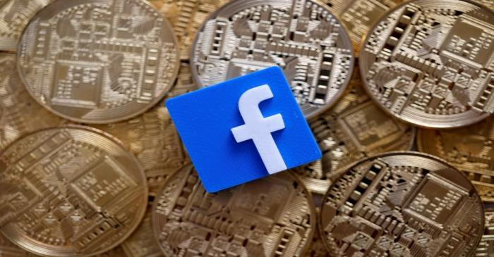 Facebook logo is seen on representations of Bitcoin virtual currency in this illustration