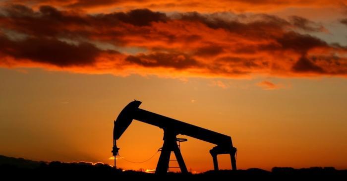 A oil pump is seen at sunset outside Scheibenhard