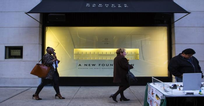 FILE PHOTO - People walk by a Barneys New York retail store in New York
