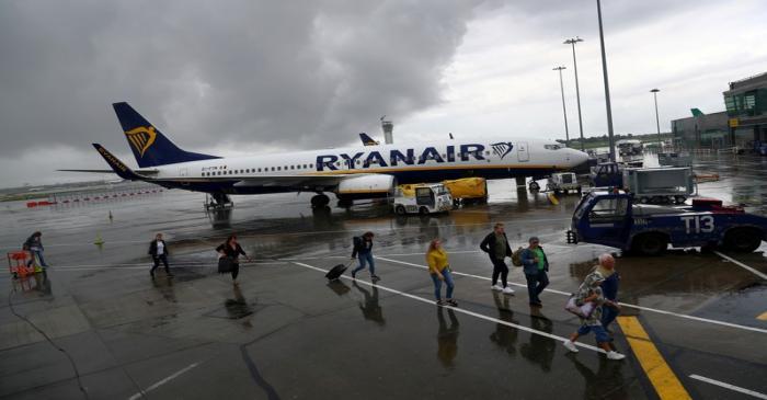 FILE PHOTO: Passengers disembark a Ryanair flight at Dublin International Airport in Dublin