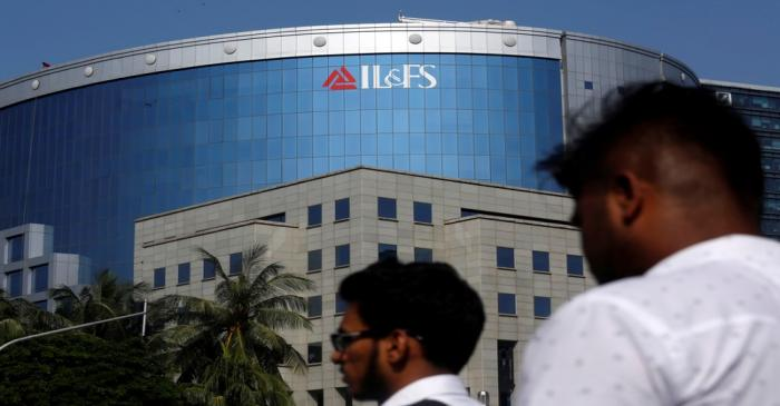 People walk past a building of IL&FS outside its headquarters in Mumbai