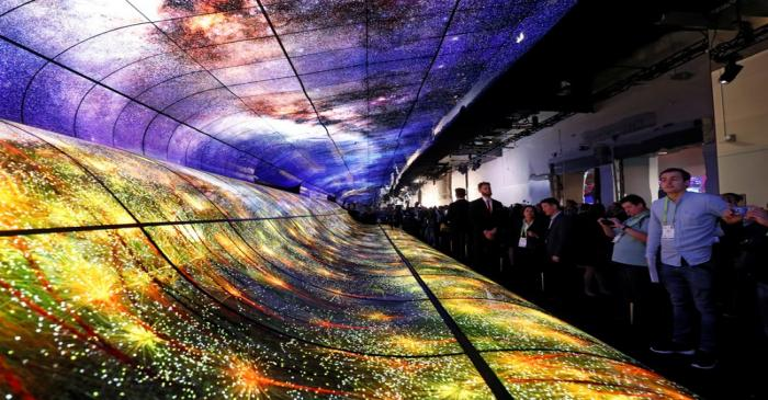 FILE PHOTO: Attendees watch a display made up of curved OLED television screens at the LG