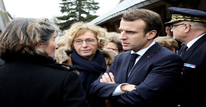 FILE PHOTO: French Labour Minister Muriel Penicaud and President Emmanuel Macron meet with