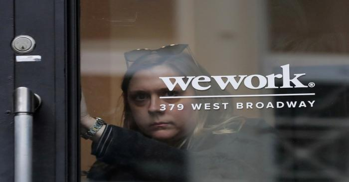FILE PHOTO: A woman exits a WeWork co-working space in New York