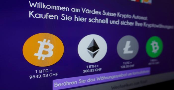 FILE PHOTO: Exchange rates and logos of Bitcoin (BTH), Ether (ETH), Litecoin (LTC) and Bitcoin
