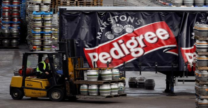 FILE PHOTO: A forklift truck driver loads a lorry with beer at Marston's Brewery in Burton upon