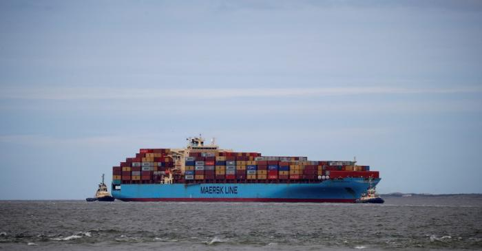 The Maersk Line container ship Maersk Sentosa is helped by tugs as it navigates the River