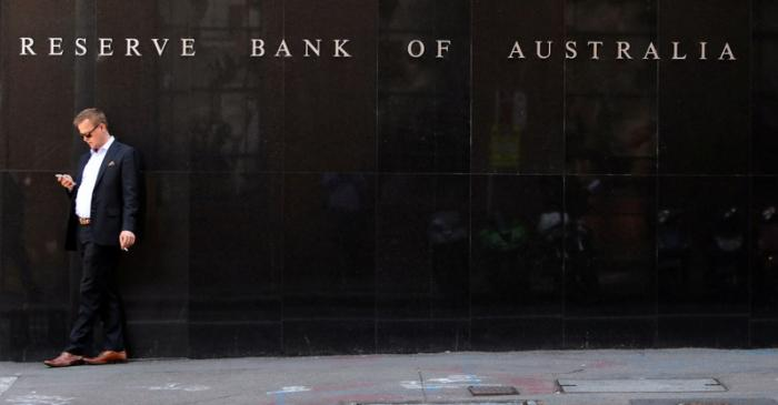 A man smokes next to the Reserve Bank of Australia headquarters in central Sydney