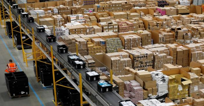 A worker moves boxes at Amazon's fulfilment centre in Peterborough