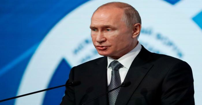 FILE PHOTO: Russian President Putin attends the International Forum