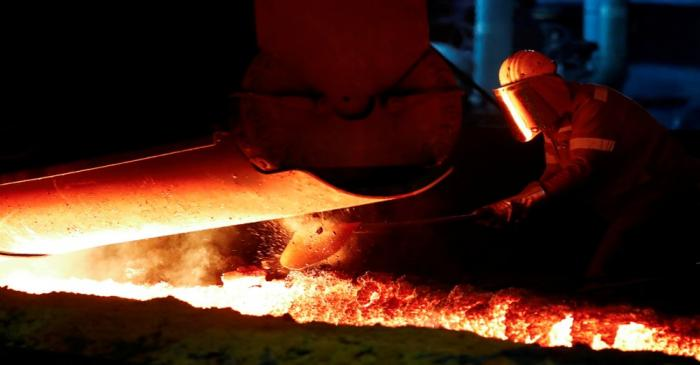 FILE PHOTO: A steel worker of Germany's industrial conglomerate ThyssenKrupp AG works near a