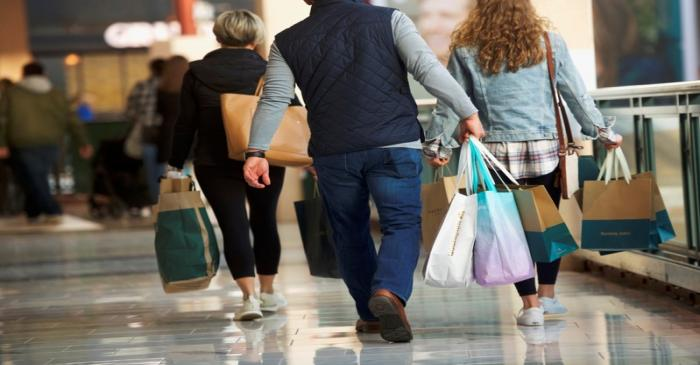 Shoppers carry bags of purchased merchandise at the King of Prussia Mall, United States'