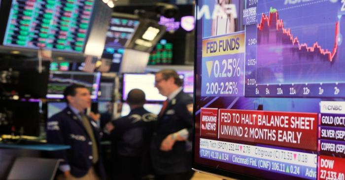 FILE PHOTO:  A screen displays the U.S. Federal Reserve interest rates announcement as traders