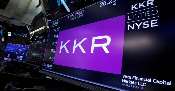 Trading information for KKR & Co is displayed on a screen on the floor of the NYSE in New York