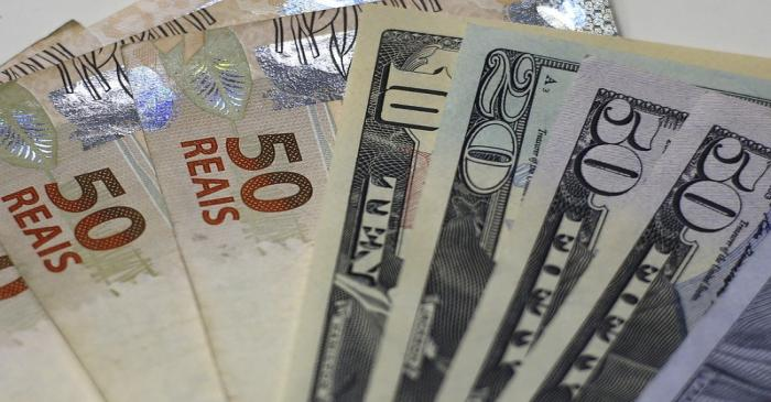 FILE PHOTO: Brazilian real and U.S. dollar notes are pictured at a currency exchange office in