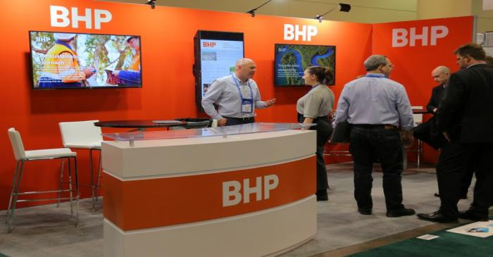 Visitors to the BHP booth speak with representatives during the PDAC convention in Toronto