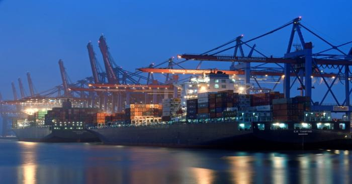 A containership at a loading terminal is seen in the port of Hamburg