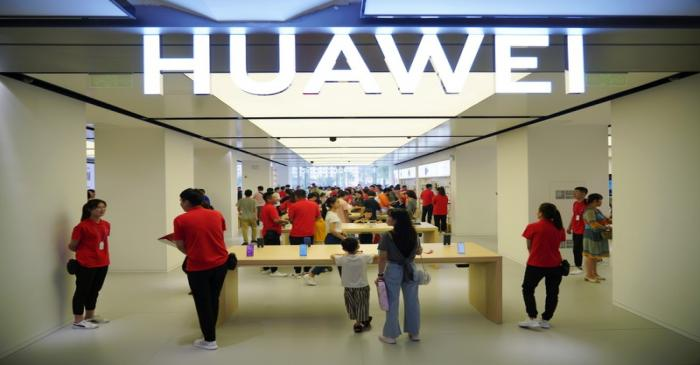People visit a newly opened Huawei store in Xian