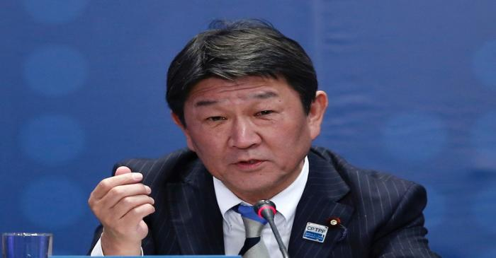 Japan's Minister of Economic Revitalization Toshimitsu Motegi speaks during the signing