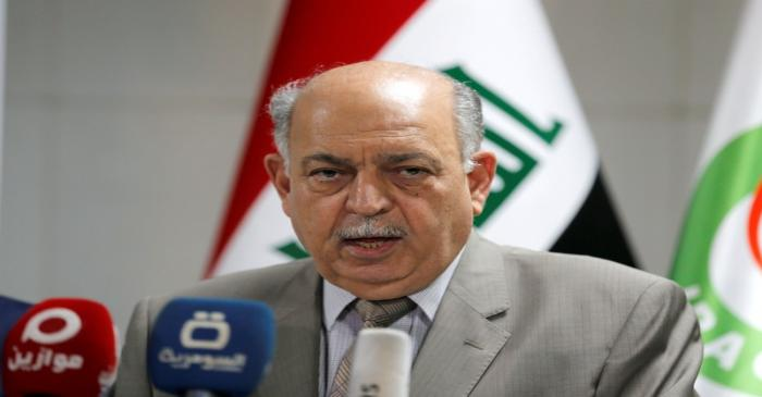 FILE PHOTO: Iraqi Oil Minister Thamer Ghadhban speaks during a news conference in Baghdad