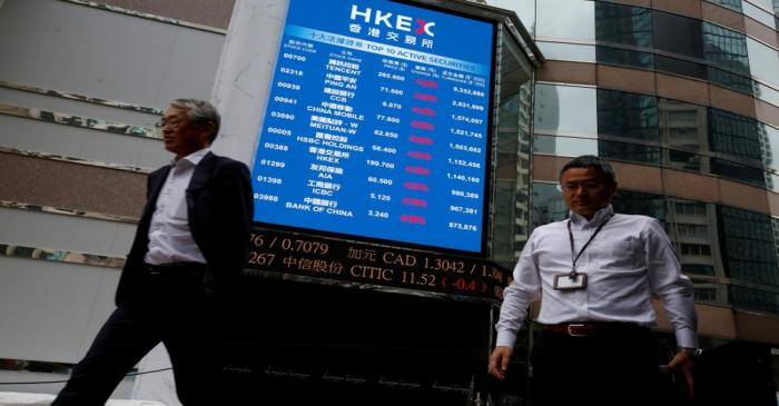 FILE PHOTO: A panel outside the Hong Kong Exchanges displays top active securities in Hong Kong