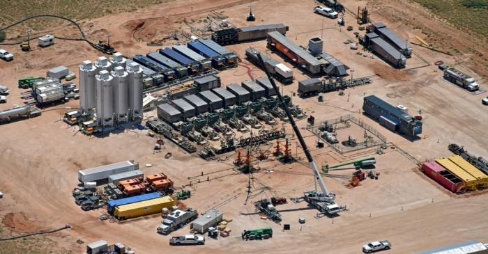 Evolution Well Services' electric hydraulic fracturing equipment is assembled at an EOG