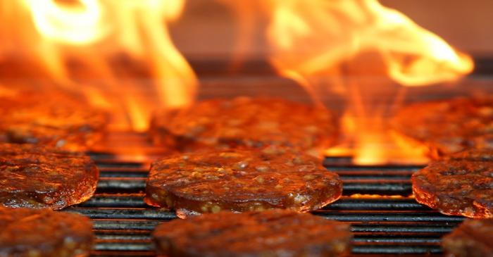 Veggie burgers are cooked over a flame on a grill in Greenwich, Connecticut
