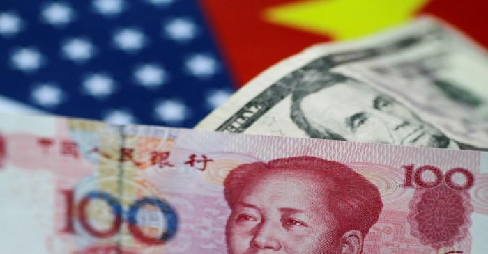 FILE PHOTO: FILE PHOTO: Illustration photo of U.S. dollar and China yuan notes
