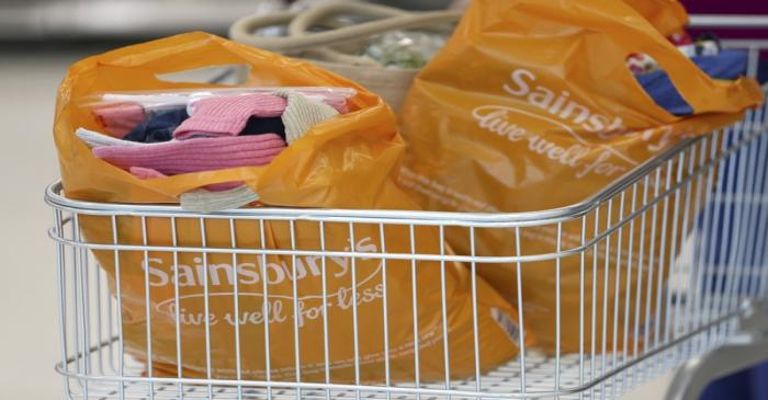 FILE PHOTO:  Bags sit in a shopping trolley at a Sainsbury's store in London