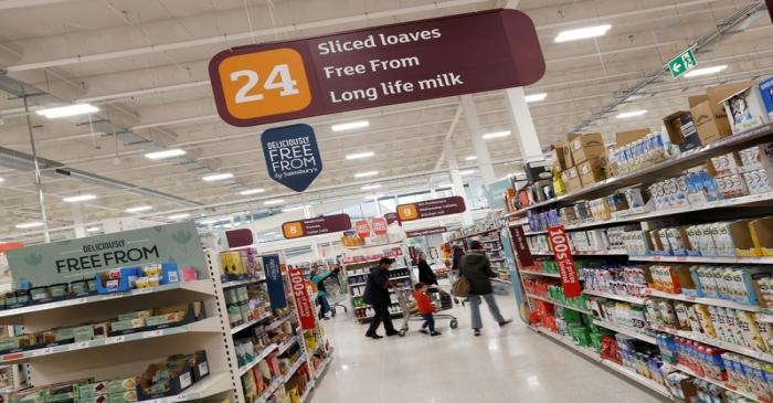 FILE PHOTO: Customers shop in a Sainsbury's store in Redhill