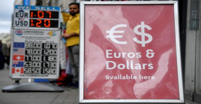 FILE PHOTO: Boards displaying buying and selling rates are seen outside of currency exchange