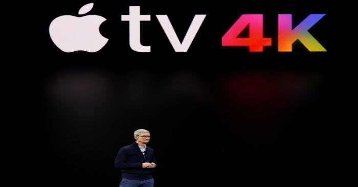 FILE PHOTO - Apple's Tim Cook speaks during a product launch event in Cupertino