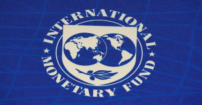 The logo of the International Monetary Fund (IMF), is seen during a news conference in Santiago