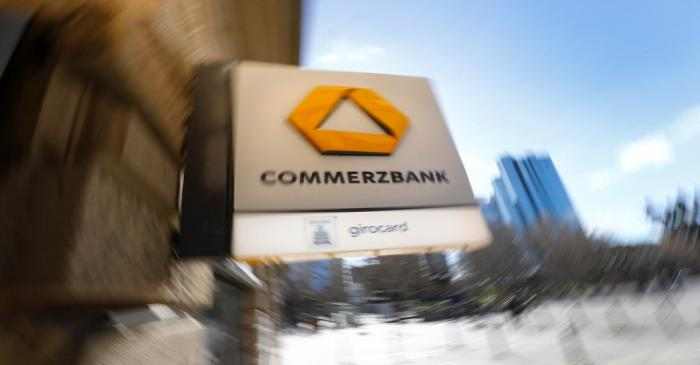 A sign for an ATM of Commerzbank is seen next to the headquarters of Deutsche Bank (R) in